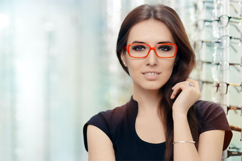 Woman red glasses smiling